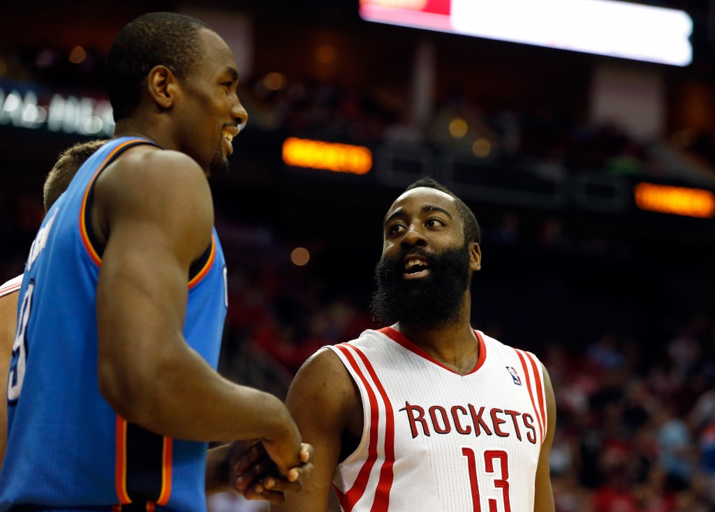 HOUSTON, TX - APRIL 04:  James Harden #13 of the Houston Rockets talks with Serge Ibaka #9 of the Oklahoma City Thunder during a game at the Toyota Center on April 4, 2014 in Houston, Texas. NOTE TO USER: User expressly acknowledges and agrees that, by downloading and or using this photograph, User is consenting to the terms and conditions of the Getty Images License Agreement.  (Photo by Scott Halleran/Getty Images)