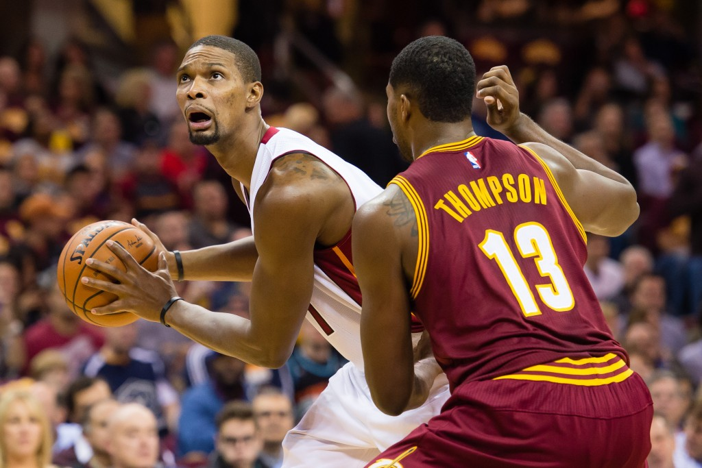 CLEVELAND, OH - OCTOBER 30: Chris Bosh #1 of the Miami Heat looks for a shot while under pressure from Tristan Thompson #13 of the Cleveland Cavaliers during the first half at Quicken Loans Arena on October 30, 2015 in Cleveland, Ohio. NOTE TO USER: User expressly acknowledges and agrees that, by downloading and or using this photograph, User is consenting to the terms and conditions of the Getty Images License Agreement. (Photo by Jason Miller/Getty Images)