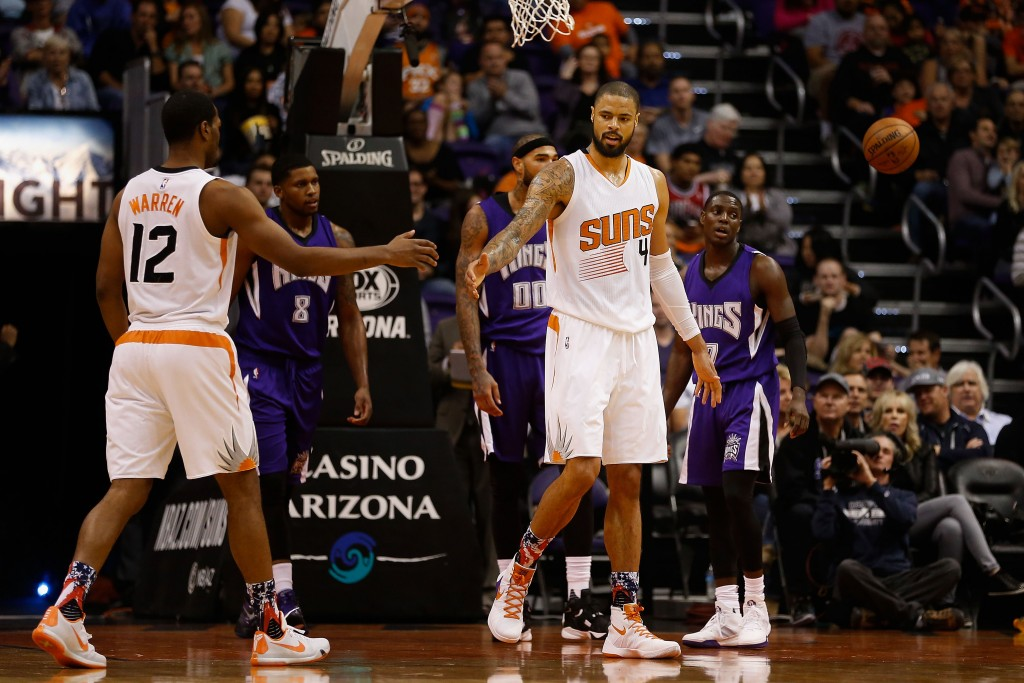 PHOENIX, AZ - NOVEMBER 04:  Tyson Chandler #4 of the Phoenix Suns high fives T.J. Warren #12 after scoring against the Sacramento Kings during the first half of the NBA game at Talking Stick Resort Arena on November 4, 2015 in Phoenix, Arizona. NOTE TO USER: User expressly acknowledges and agrees that, by downloading and or using this photograph, User is consenting to the terms and conditions of the Getty Images License Agreement.  (Photo by Christian Petersen/Getty Images)
