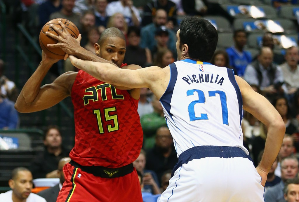 DALLAS, TX - DECEMBER 09:  Al Horford #15 of the Atlanta Hawks dribbles the ball past Zaza Pachulia #27 of the Dallas Mavericks at American Airlines Center on December 9, 2015 in Dallas, Texas.  NOTE TO USER:  User expressly acknowledges and agrees that, by downloading and or using photograph, User is consenting to the terms and conditions of the Getty Images License Agreement.  (Photo by Ronald Martinez/Getty Images)