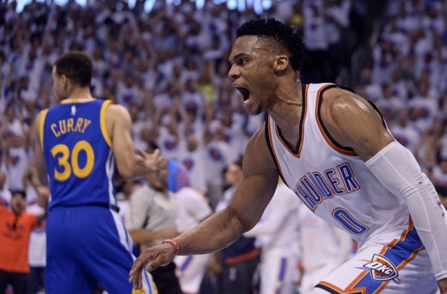 May 24, 2016; Oklahoma City, OK, USA; Oklahoma City Thunder guard Russell Westbrook (0) reacts in front of Golden State Warriors guard Stephen Curry (30) during the first quarter in game four of the Western conference finals of the NBA Playoffs at Chesapeake Energy Arena. Mandatory Credit: Mark D. Smith-USA TODAY Sports