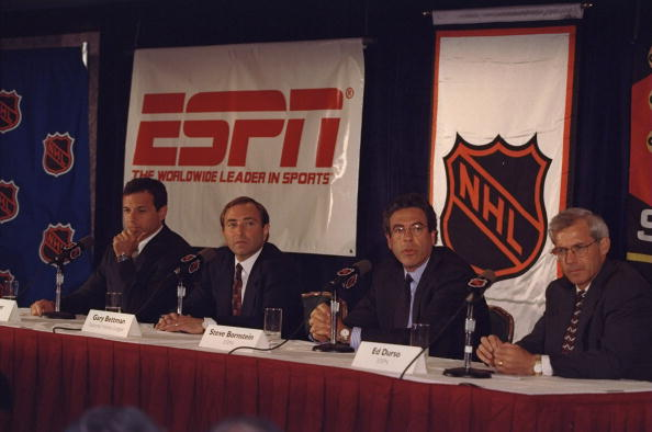 25 Aug 1998:  NHL Commissioner Gary Bettman (C) with Roger Iger of ABC and Steve Bornstein of ESPN (R) during the ESPN/NHL contract signing in New York, New York. Mandatory Credit: Al Bello  /Allsport