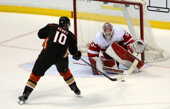 ANAHEIM, CA - FEBRUARY 23:  Corey Perry #10 of the Anaheim Ducks shoots and scores in the shootout against goalie Jimmy Howard #35 of the Detroit Red Wings at Honda Center on February 23, 2015 in Anaheim, California.  The Ducks won 4-3 in a shootout.  (Photo by Stephen Dunn/Getty Images)