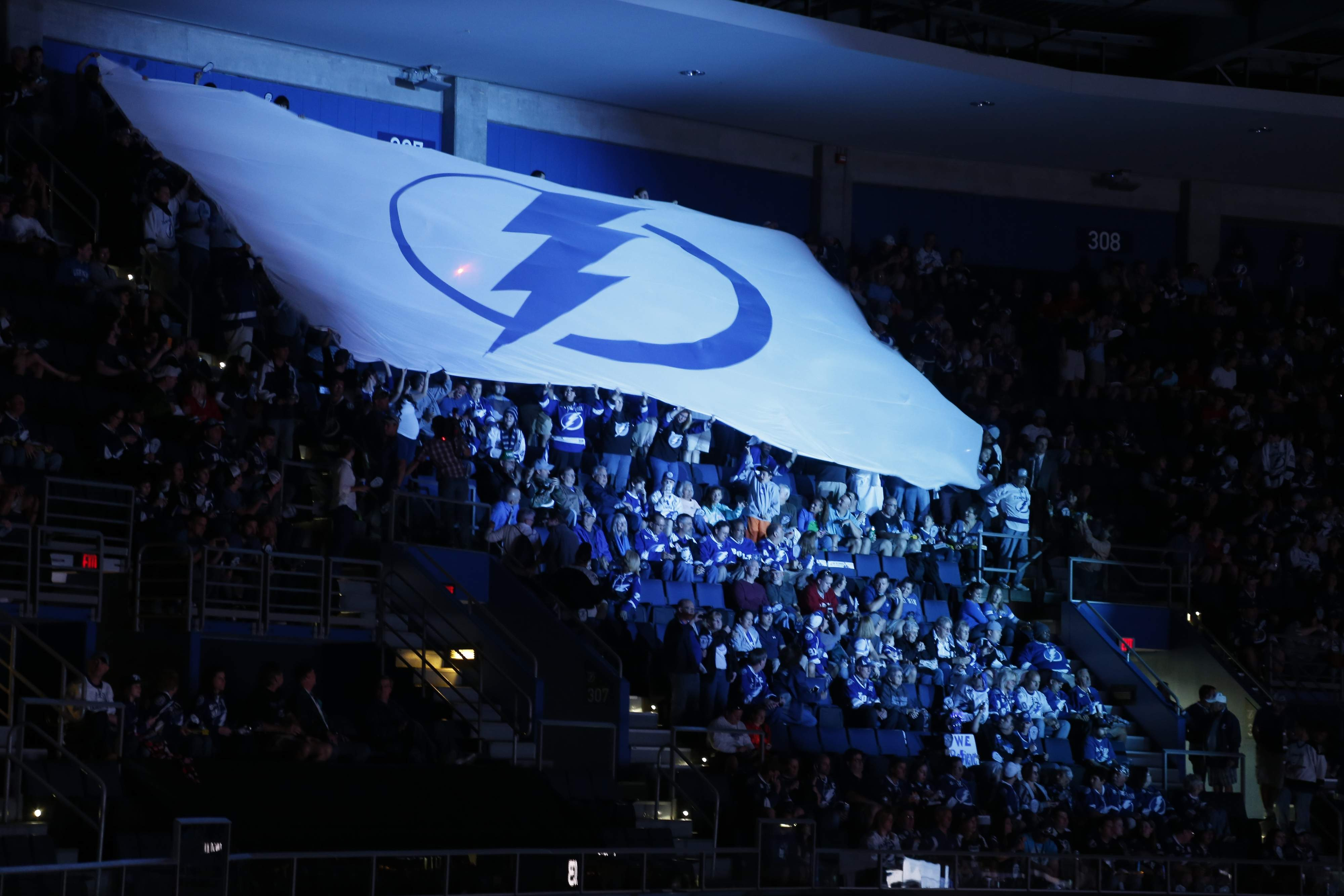 cd158d15a8d Red Wings fan tried to torch a giant Lightning flag inside Amalie Arena