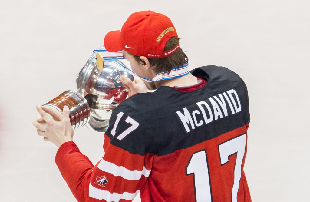 TORONTO, ON - JANUARY 05: Connor McDavid #17 of Canada celebrates with the trophy after a 5-4 win against Russia during the Gold medal game of the 2015 IIHF World Junior Championship on January 05, 2015 at the Air Canada Centre in Toronto, Ontario, Canada. (Photo by Dennis Pajot/Getty Images)