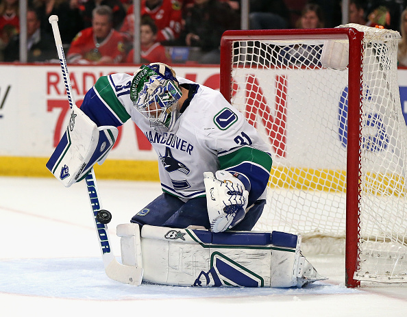 CHICAGO, IL - APRIL 02:  Eddie Lack #31 of the Vancouver Canucks makes a save against the Chicago Blackhawks at the United Center on April 2, 2015 in Chicago, Illinois. The Blackhawks defeated the Canucks 3-1.  (Photo by Jonathan Daniel/Getty Images)