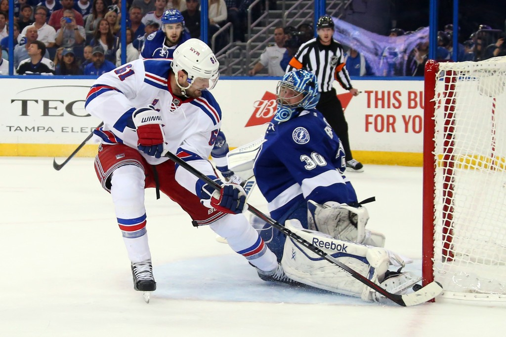 TAMPA, FL - MAY 22:  Rick Nash #61 of the New York Rangers scores a goal during the first period against Ben Bishop #30 of the Tampa Bay Lightning in Game Four of the Eastern Conference Finals during the 2015 NHL Stanley Cup Playoffs at Amalie Arena on May 22, 2015 in Tampa, Florida.  (Photo by Bruce Bennett/Getty Images)