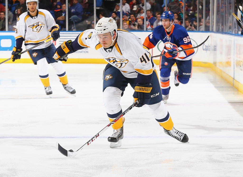UNIONDALE, NY - NOVEMBER 12:  Taylor Beck #41 of the Nashville Predators in action against the New York Islanders during their game at the Nassau Veterans Memorial Coliseum on November 12, 2013 in Uniondale, New York.  (Photo by Al Bello/Getty Images)