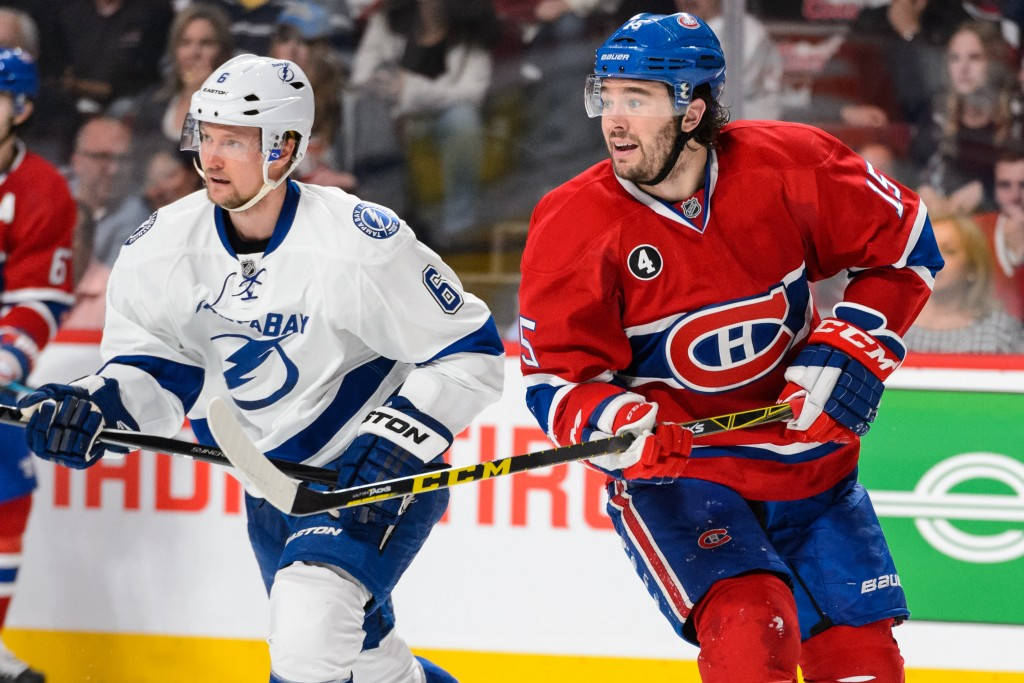 MONTREAL, QC - MAY 09:  P.A. Parenteau #15 of the Montreal Canadiens and Anton Stralman #6 of the Tampa Bay Lightning skate side by side in Game Five of the Eastern Conference Semifinals during the 2015 NHL Stanley Cup Playoffs at the Bell Centre on May 9, 2015 in Montreal, Quebec, Canada. The Canadiens defeated the Lightning 2-1.  The Lightning lead the series 3-2. (Photo by Minas Panagiotakis/Getty Images)