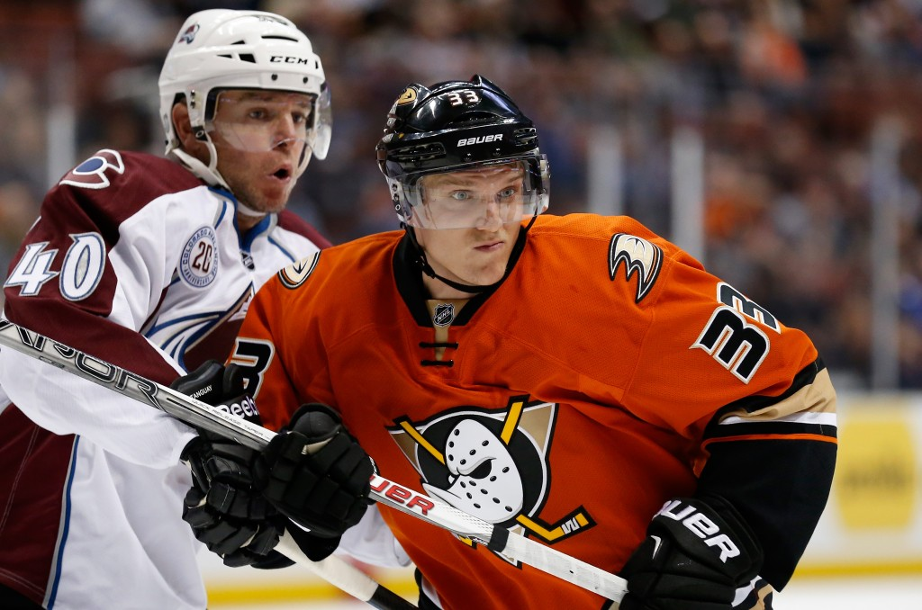 ANAHEIM, CA - OCTOBER 16:  Alex Tanguay #40 of the Colorado Avalanche battles for position with Jakob Silfverberg #33 of the Anaheim Ducks during the first period of a game at Honda Center on October 16, 2015 in Anaheim, California.  (Photo by Sean M. Haffey/Getty Images)