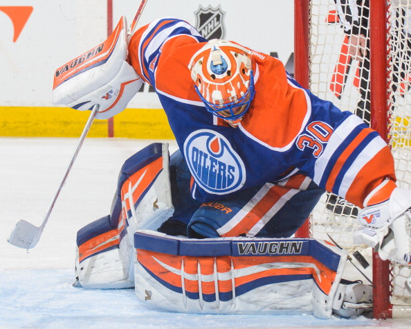 EDMONTON, AB - APRIL 8:  Ben Scrivens #30 of the Edmonton Oilers watches the shot of Paul Stastny (not pictured) of the Colorado Avalanche fly past him during an NHL game at Rexall Place on April 8, 2014 in Edmonton, Alberta, Canada. (Photo by Derek Leung/Getty Images)