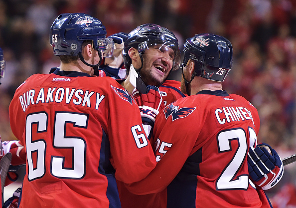 WASHINGTON, DC - JANUARY 10: Alex Ovechkin #8 of the Washington Capitals celebrates his 500th career NHL goal in the second period with teammates Andre Burakovsky #65 and Jason Chimera #25 against the Ottawa Senators at the Verizon Center on January 10, 2016 in Washington, DC. (Photo by Drew Hallowell/Getty Images)