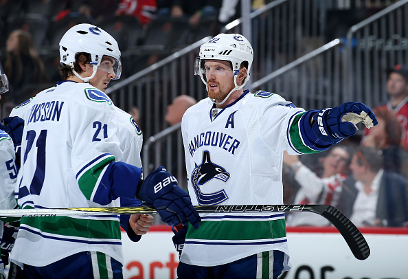 NEWARK, NJ - DECEMBER 06:  Daniel Sedin #22 of the Vancouver Canucks talks with Loui Eriksson #21 in the first period against the New Jersey Devils on December 6, 2016 at Prudential Center in Newark, New Jersey.  (Photo by Elsa/Getty Images)