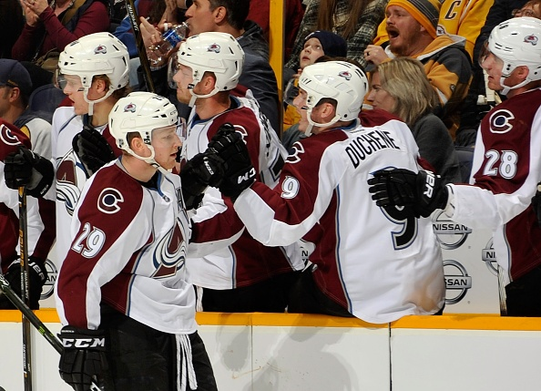 NASHVILLE, TN - DECEMBER 06:  Matt Duchene #9 and Patrick Wiercioch #28 of the Colorado Avalanche congratulate teammate Nathan MacKinnon #29 on scoring a goal against the Nashville Predators during the first period at Bridgestone Arena on December 6, 2016 in Nashville, Tennessee.  (Photo by Frederick Breedon/Getty Images)