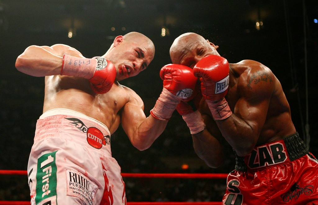 NEW YORK - JUNE 09:  Cotto lands a left uppercut on Zab Judah.  (Photo by Nick Laham/Getty Images)