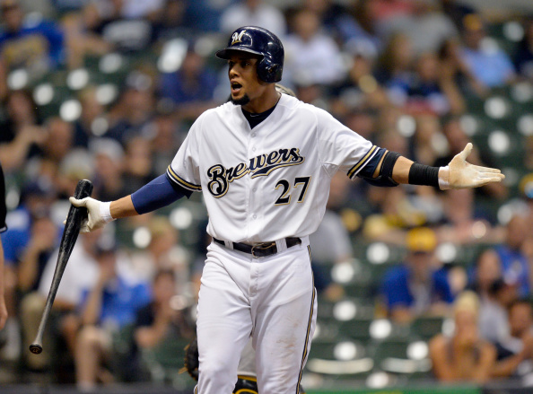 MILWUAKEE, WI - AUGUST 22:  Carlos Gomez #27 of the Milwaukee Brewers complains about the umpire's ruling on a pitch during the ninth inning against the Pittsburgh Pirates at Miller Park on August 22, 2014 in Milwaukee, Wisconsin. The Pirates defeated the Brewers 8-3.  (Photo by Brian Kersey/Getty Images)
