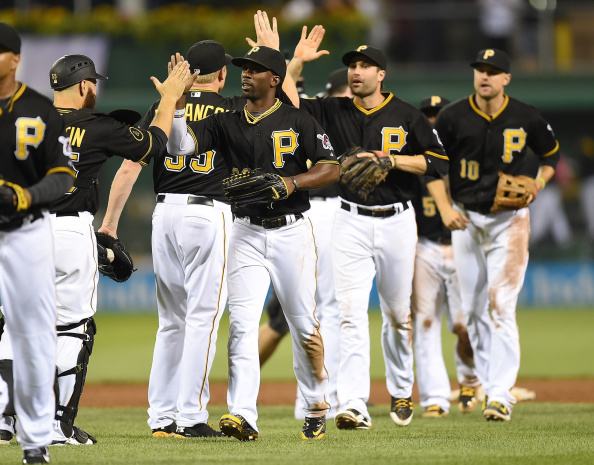 PITTSBURGH, PA - AUGUST 29:  Andrew McCutchen #22 of the Pittsburgh Pirates celebrates with Russell Martin #55 after a 2-1 win over the Cincinnati Reds on August 29, 2014 at PNC Park in Pittsburgh, Pennsylvania.  (Photo by Joe Sargent/Getty Images)