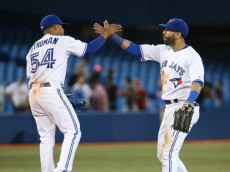 Marcus Stroman and Jose Bautista of the Blue Jays