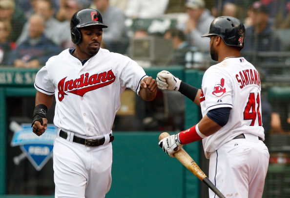 CLEVELAND, OH - SEPTEMBER 11:  Michael Bourn #24 of the Cleveland Indians is congratulated by Carlos Santana #41 after scoring on a single by Michael Brantley #23 (not pictured) during the sixth inning against the Minnesota Twins  on September 11, 2014 at Progressive Field in Cleveland, Ohio.(Photo by David Maxwell/Getty Images)