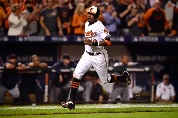 BALTIMORE, MD - OCTOBER 02:  Adam Jones #10 of the Baltimore Orioles scores off a single in the eighth inning against the Detroit Tigers during Game One of the American League Division Series at Oriole Park at Camden Yards on October 2, 2014 in Baltimore, Maryland.  (Photo by Patrick Smith/Getty Images)