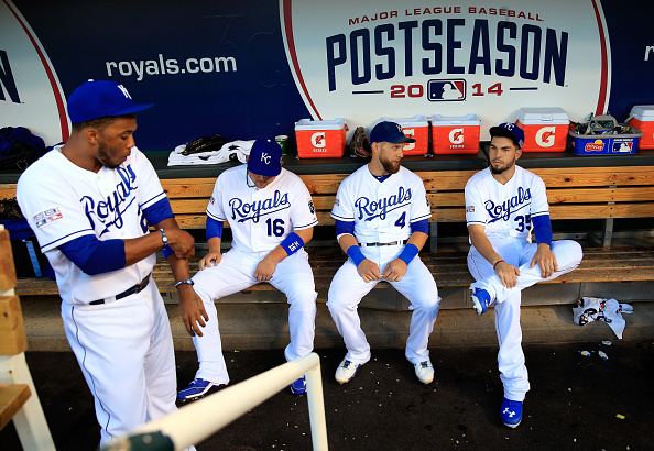 KANSAS CITY, MO - OCTOBER 05:  Alex Gordon #4 and Eric Hosmer #35 of the Kansas City Royals sit in the dugout ahead of Game Three of the American League Division Series against the Los Angeles Angels at Kauffman Stadium on October 5, 2014 in Kansas City, Missouri.  (Photo by Jamie Squire/Getty Images)