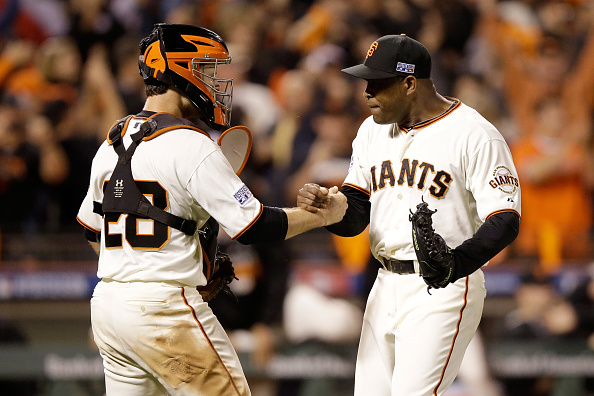 SAN FRANCISCO, CA - OCTOBER 15:  Santiago Casilla #46 and Buster Posey #28 of the San Francisco Giants celebrate after getting the final out in the ninth inning against the St. Louis Cardinals during Game Four of the National League Championship Series at AT&T Park on October 15, 2014 in San Francisco, California.  (Photo by Ezra Shaw/Getty Images)