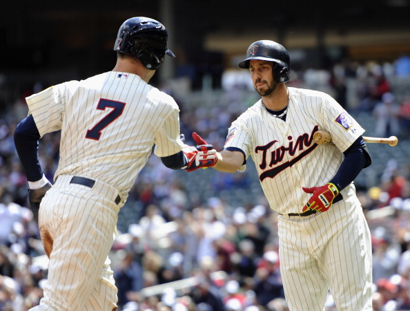 MINNEAPOLIS, MN - MAY 3: Chris Colabello #20 of the Minnesota Twins congratulates teammate Joe Mauer #7 of the Minnesota Twins on scoring a run against the Baltimore Orioles during the first inning of the game on May 3, 2014 at Target Field in Minneapolis, Minnesota. (Photo by Hannah Foslien/Getty Images)