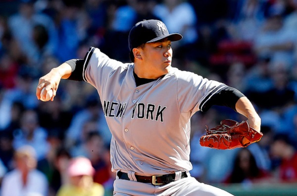 BOSTON, MA - SEPTEMBER 27:  Masahiro Tanaka #19 of the New York Yankees pitches against the Boston Red Sox in the first inning during a game at Fenway Park on September 27, 2014 in Boston, Massachusetts.  (Photo by Jim Rogash/Getty Images)