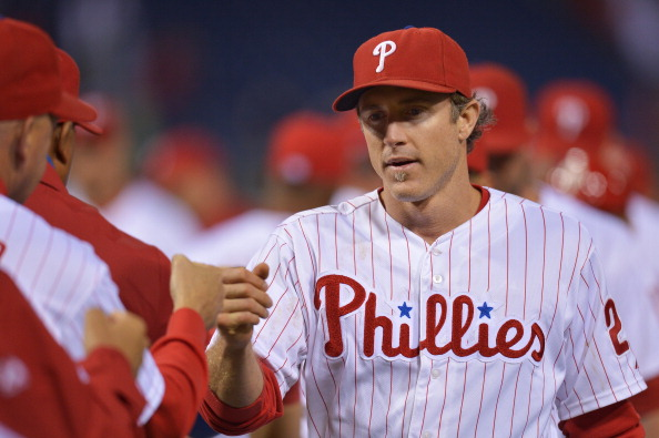 PHILADELPHIA, PA - SEPTEMBER 17:  Chase Utley #26 of the Philadelphia Phillies celebrates with teammates after a win over the the Miami Marlins 6-4 at Citizens Bank Park on September 17, 2013 in Philadelphia, Pennsylvania.  (Photo by Drew Hallowell/Getty Images)