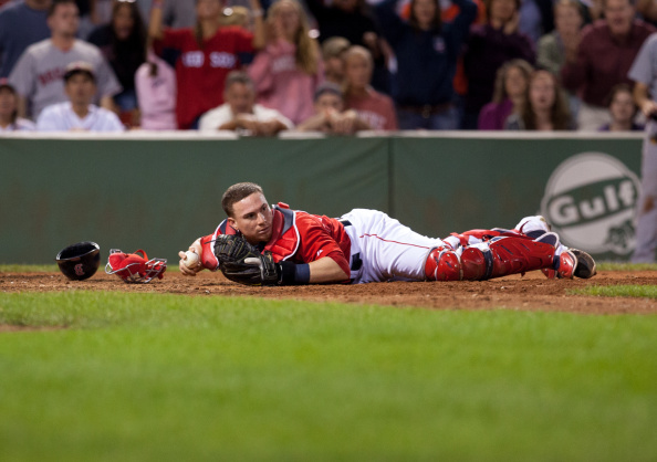 BOSTON, MA - AUGUST 22: Christian Vazquez #55 of the Boston Red Sox lays in the dirt after unsuccessfully tagging a player from the Seattle Mariners during the ninth inning at Fenway Park on August 22, 2014 in Boston, Massachusetts. The Mariners won 5-3 scoring all 5 runs in the ninth inning. (Photo by Rich Gagnon/Getty Images)