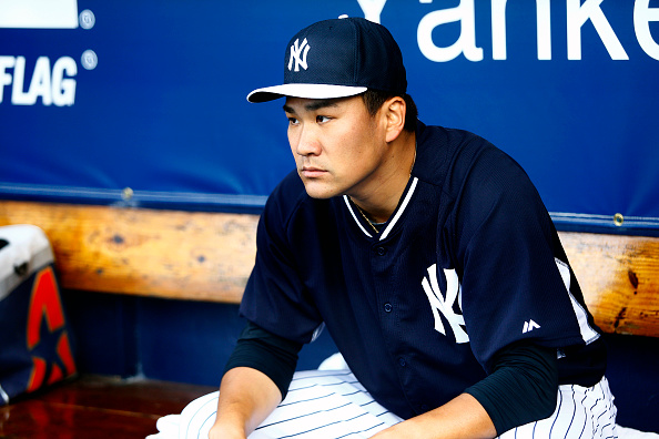 TAMPA, FL - MARCH 12:  Pitcher Masahiro Tanaka #19 of the New York Yankees waits in the dugout before starting a spring training game against the Atlanta Braves on March 12, 2015 at George M. Steinbrenner Field in Tampa, Florida.  (Photo by Brian Blanco/Getty Images)