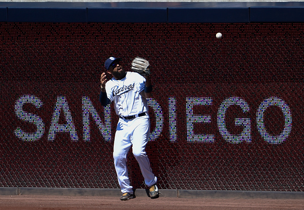 SAN DIEGO, CA - SEPTEMBER 7:  Matt Kemp #27 of the San Diego Padres can't make the catch at the wall on a ball hit by Daniel Descalso #3 of the Colorado Rockies during the thirdinning of a baseball game at Petco Park September 7, 2015 in San Diego, California.  Kemp was charged with an error on the play. (Photo by Denis Poroy/Getty Images)
