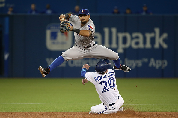 TORONTO, ON - OCTOBER 08:  Rougned Odor #12 of the Texas Rangers collides with Josh Donaldson #20 of the Toronto Blue Jays after taggin him out in the fourth inning during game one of the American League Division Series at Rogers Centre on October 8, 2015 in Toronto, Ontario, Canada.  (Photo by Tom Szczerbowski/Getty Images)