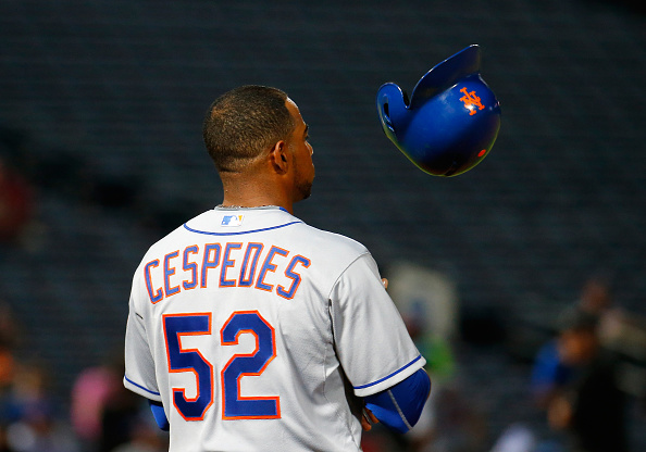 ATLANTA, GA - SEPTEMBER 10:  Yoenis Cespedes #52 of the New York Mets tosses his helmet at first base while waiting on a pitching change by the Atlanta Braves in the seventh inning at Turner Field on September 10, 2015 in Atlanta, Georgia.  (Photo by Kevin C. Cox/Getty Images)