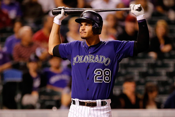 DENVER, CO - AUGUST 31: Nolan Arenado #28 of the Colorado Rockies reacts as he takes an at bat against the Colorado Rockies at Coors Field on August 31, 2015 in Denver, Colorado. The Rockies defeated the Diamondbacks 5-4. (Photo by Doug Pensinger/Getty Images)