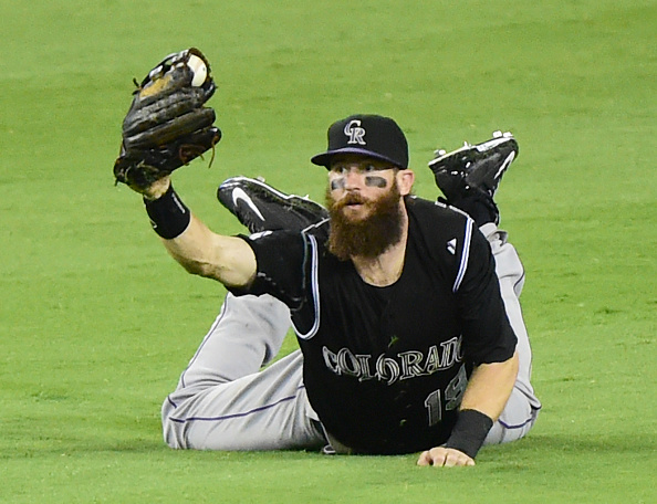 LOS ANGELES, CA - SEPTEMBER 15:  Charlie Blackmon #19 of the Colorado Rockies reacts after trapping a single from Chase Utley #26 of the Los Angeles Dodgers during the sixth inning at Dodger Stadium on September 15, 2015 in Los Angeles, California.  (Photo by Harry How/Getty Images)