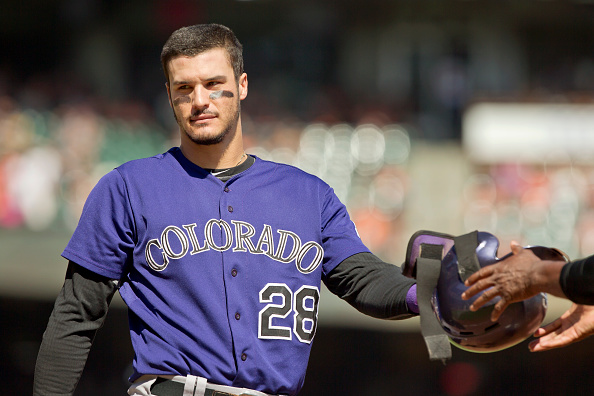 SAN FRANCISCO, CA - OCTOBER 4: Nolan Arenado #28 of the Colorado Rockies hands off his helmet after grounding into a fielders choice against the San Francisco Giants in the third inning at AT&T Park on October 4, 2015 in San Francisco, California, during the final day of the regular season. The Rockies won 7-3. (Photo by Brian Bahr/Getty Images)