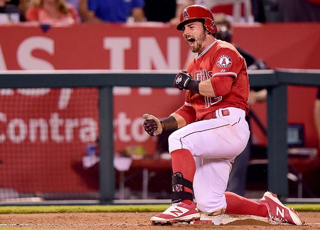 ANAHEIM, CA - SEPTEMBER 25: Johnny Giavotella #12 of the Los Angeles Angels celebrates his triple to score David Freese #6 to take a 6-3 lead over the Seattle Mariners during the sixth inning at Angel Stadium of Anaheim on September 25, 2015 in Anaheim, California. (Photo by Harry How/Getty Images)
