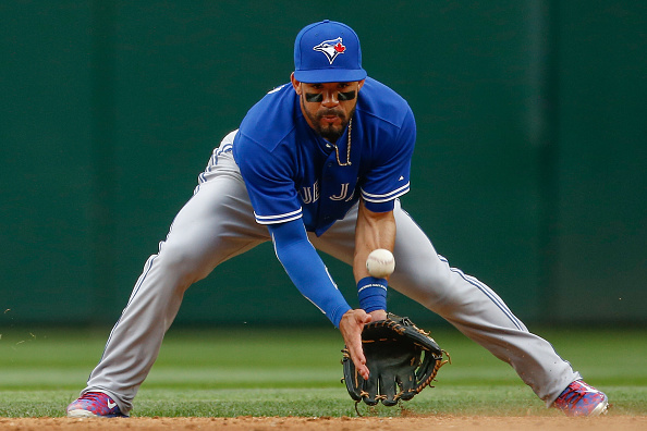 SEATTLE, WA - JULY 25:  Second baseman Devon Travis #29 of the Toronto Blue Jays misplays a grounder off the bat of Robinson Cano of the Seattle Mariners in the third inning at Safeco Field on July 25, 2015 in Seattle, Washington. Travis was charged with an error on the play. (Photo by Otto Greule Jr/Getty Images)