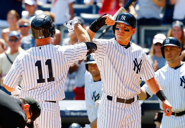 NEW YORK, NY - AUGUST 22:  Brett Gardner #11 of the New York Yankees celebrates his first inning two-run home run against the Cleveland Indians with teammate Jacoby Ellsbury #22 at Yankee Stadium on August 22, 2015 in the Bronx borough of New York City.  (Photo by Jim McIsaac/Getty Images)