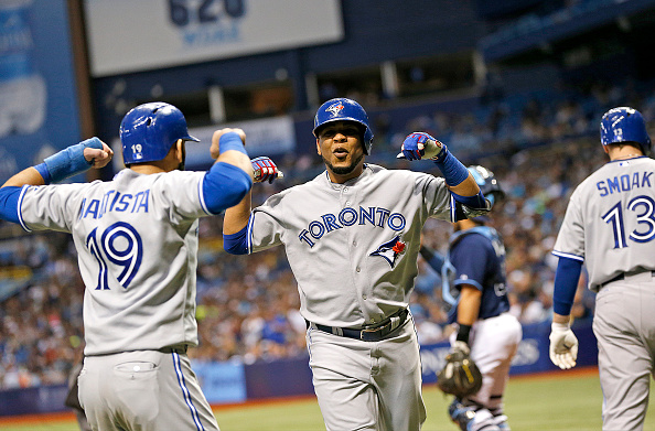 ST. PETERSBURG, FL - OCTOBER 3:  Edwin Encarnacion #10 of the Toronto Blue Jays celebrates his two-run home run with teammate Jose Bautista #19 during the sixth inning of a game against the Tampa Bay Rays on October 3, 2015 at Tropicana Field in St. Petersburg, Florida.  (Photo by Brian Blanco/Getty Images)
