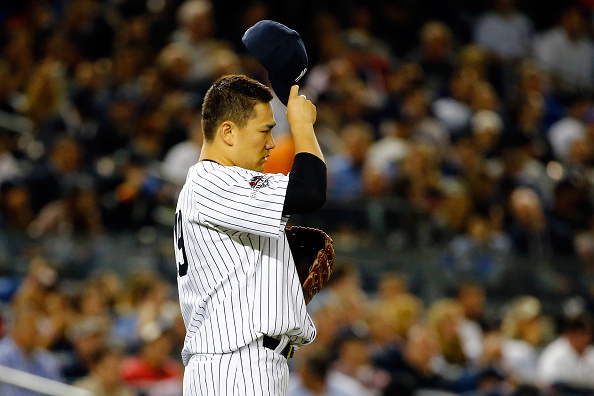 NEW YORK, NY - OCTOBER 06: Masahiro Tanaka #19 of the New York Yankees reacts after giving up a double to George Springer #4 of the Houston Astros in the third inning during the American League Wild Card Game at Yankee Stadium on October 6, 2015 in New York City. (Photo by Al Bello/Getty Images)
