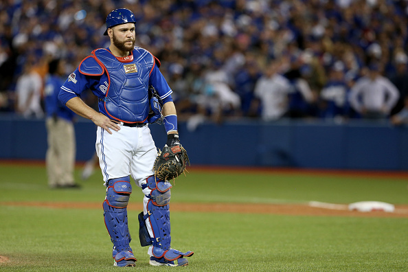 TORONTO, ON - OCTOBER 14:  Russell Martin #55 of the Toronto Blue Jays reacts in the seventh inning after an error was called on Martin allowing a run to score for the Texas Rangers in game five of the American League Division Series at Rogers Centre on October 14, 2015 in Toronto, Canada.  (Photo by Vaughn Ridley/Getty Images)