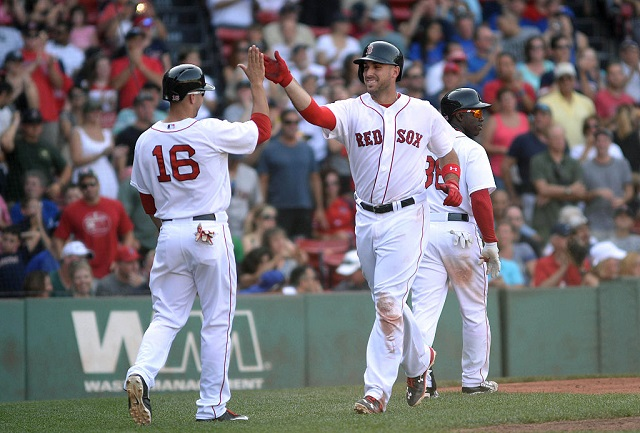 BOSTON, MA - SEPTEMBER 7: Travis Shaw #47 of the Boston Red Sox slaps high fives after hitting a two run homer in the eighth inning against the Toronto Blue Jays at Fenway Park on September 7, 2015 in Boston, Massachusetts. (Photo by Darren McCollester/Getty Images)