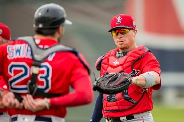 FT. MYERS, FL - MARCH  3: Christian Vazquez #7 of the Boston Red Sox high fives Blake Swihart #23 during a team workout on March 3, 2016 at Fenway South in Fort Myers, Florida . (Photo by Billie Weiss/Boston Red Sox/Getty Images) *** Local Caption *** Blake Swihart; Christian Vazquez