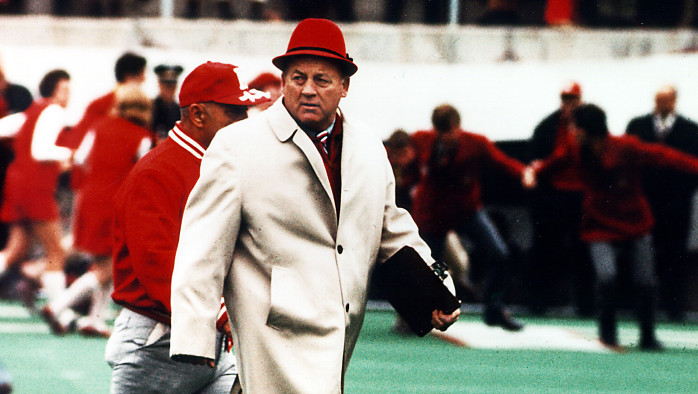 Before Tom Osborne reigned in Lincoln, Bob Devaney established Nebraska as a national powerhouse. Osborne is the name most closely associated with Nebraska football, especially as his successors have failed to maintain what he developed. Yet, all that Osborne developed flowed from what Devaney originally built. (Photo courtesy of the Nebraska sports magazine Hail Varsity)