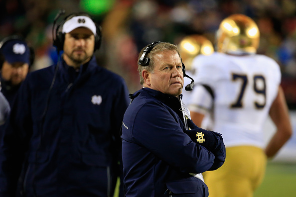 LANDOVER, MD - NOVEMBER 01: Head coach Brian Kelly of the Notre Dame Fighting Irish looks on from the sidelines during the first half against the Navy Midshipmen at FedExField on November 1, 2014 in Landover, Maryland.  (Photo by Rob Carr/Getty Images)
