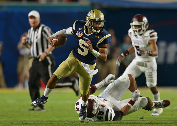 MIAMI GARDENS, FL - DECEMBER 31:  Justin Thomas #5 of the Georgia Tech Yellow Jackets runs during the first half of the Capital One Orange Bowl game against the Mississippi State Bulldogs at Sun Life Stadium on December 31, 2014 in Miami Gardens, Florida.  (Photo by Mike Ehrmann/Getty Images)