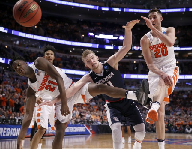 Gonzaga's Domantas Sabonis (11) is fouled by Syracuse's Tyler Roberson (21) as Tyler Lydon (20) blocks a shot  during the second half of a college basketball game in the regional semifinals of the NCAA Tournament, Friday, March 25, 2016, in Chicago. (AP Photo/Charles Rex Arbogast)