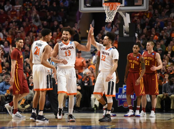 Mar 25, 2016; Chicago, IL, USA; Virginia Cavaliers forward Anthony Gill (13) and forward Isaiah Wilkins (21) and guard London Perrantes (32) celebrate after a basket against the Iowa State Cyclones during the second half in a semifinal game in the Midwest regional of the NCAA Tournament at United Center. Mandatory Credit: David Banks-USA TODAY Sports